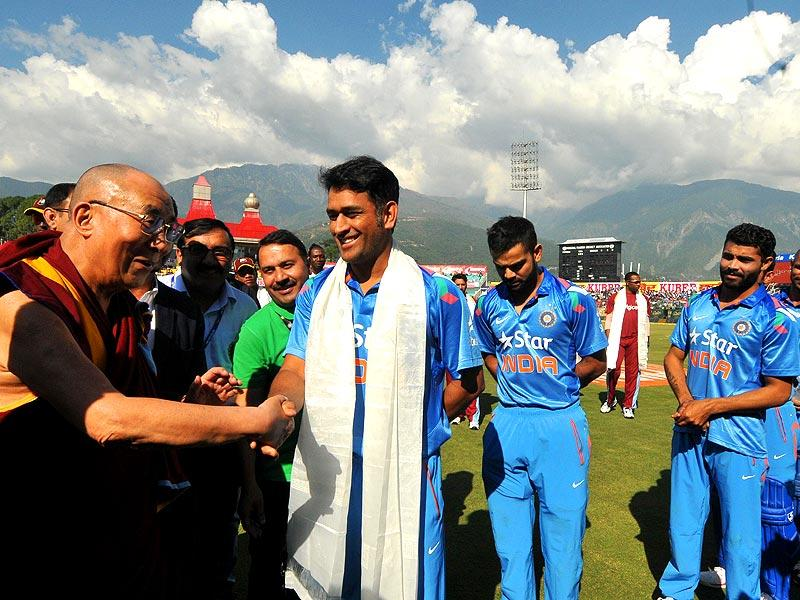Tibetan spiritual leader The Dalai Lama interact with Indian player MS Dhoni during 4th ODI at HPCA Stadium in Dharamshala. (Photo by Keshav Singh/Hindustan Times)