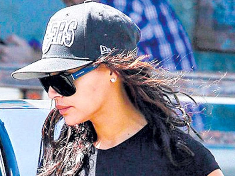 Actor Naya Rivera keeps it simple yet chic in an all-black look of a floaty sundress, sport shoes and baseball cap.
