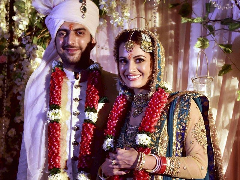 Dia Mirza poses with her long-time beau Sahil Sangha after she got married in New Delhi on Saturday, October 18. (PTI Photo)
