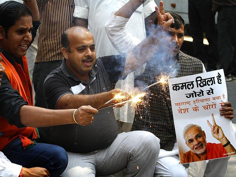 BJP supporters light crackers celebrating the party's victory in Haryana and Maharashtra Assembly elections at the BJP Headquarters, in New Delhi. (Arvind Yadav/HT Photo)