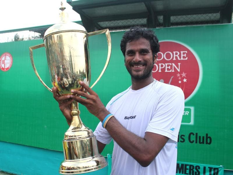 India's Saketh Myneni poses with the trophy after winning ATP Challenger Series title, in Indore on Sunday. (Shankar Mourya/HT photo)