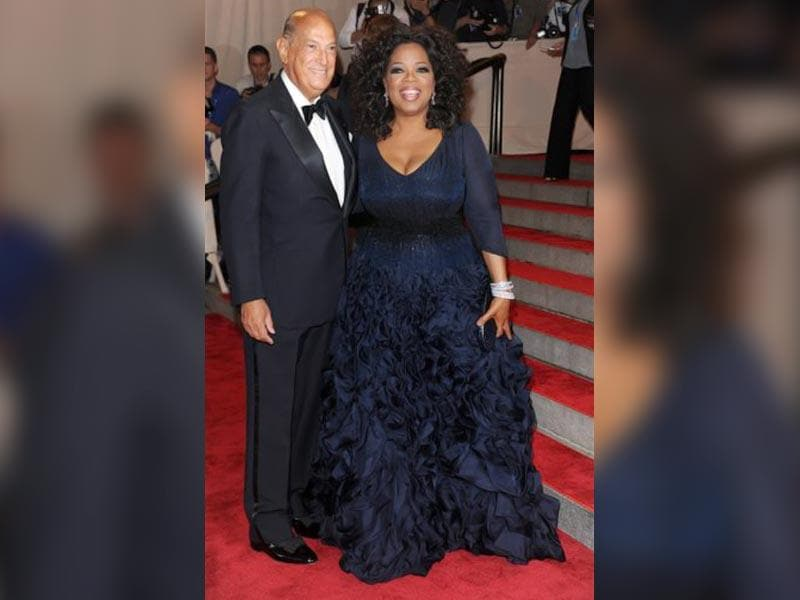 In this May 3, 2010 file photo, Oprah Winfrey, right, and Oscar de la Renta arrive at the Metropolitan Museum of Art Costume Institute gala, in New York. The designer was a favorite of socialites and movie stars alike. (AP)