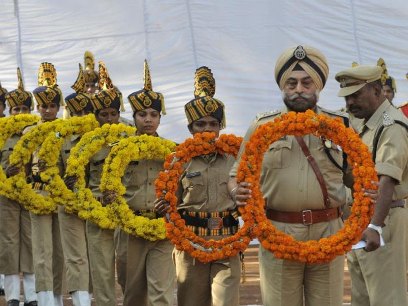 Police personnel observe Police Martyr's Day at Lal Parade Ground in Bhopal on Tuesday. (Praveen Bajpai/HT photo)
