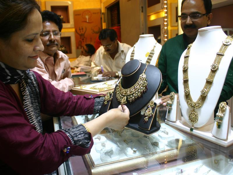 A woman purchases jewellery on the occasion of Dhanteras, in Bhopal on Tuesday. (HT photo)