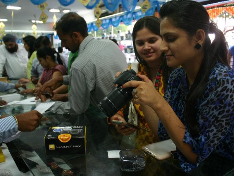 A girl buying a camera at an electronic goods shop on the occasion of Dhanteras, in Bhopal on Tuesday. (HT photo)