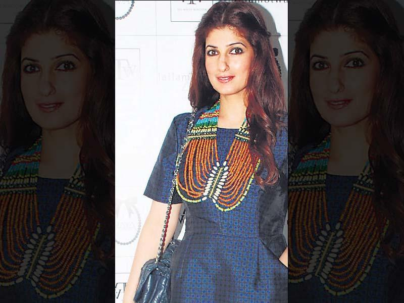 Just bead it – Twinkle Khanna Twinkle was recently spotted at a promotional event where she paired a dress with coral, feroza and other semi-precious stone strings. Combining many a strings together, she added colour to the otherwise dark blue simple outfit.