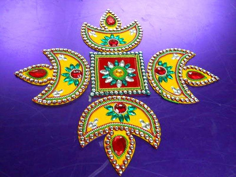 No Diwali is complete without a rangoli. If you wish to try something new, try this - make cardboard cut-outs for patterns you fancy and then revv them up with sequins, beads, glitter powder, lace, stones, buttons, et al. (Photo: www.reancehandicraftsitem.com)