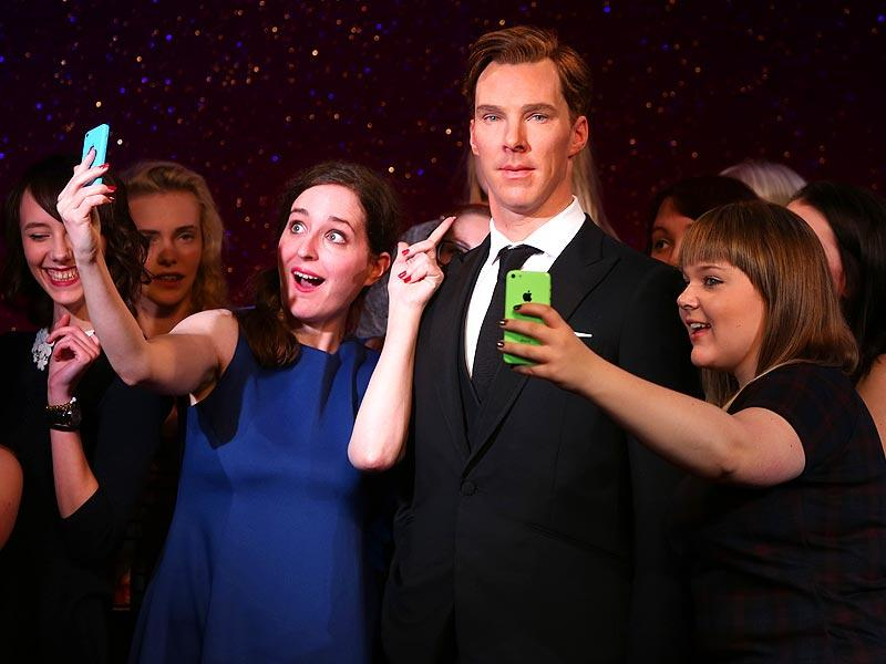 Sherlock Holmes never existed, but his fictional address of 221B Baker Street still receives a steady flow of letters addressed to the detective. The latest tribute to Benedict Cumberbatch (who plays the role of Sherlock) comes from Madame Tussauds.  Fans takes selfies around the new wax figure of Benedict Cumberbatch as it is unveiled at Madame Tussauds in central London, Tuesday, October 21, 2014. (Photo: AP/Joel Ryan)