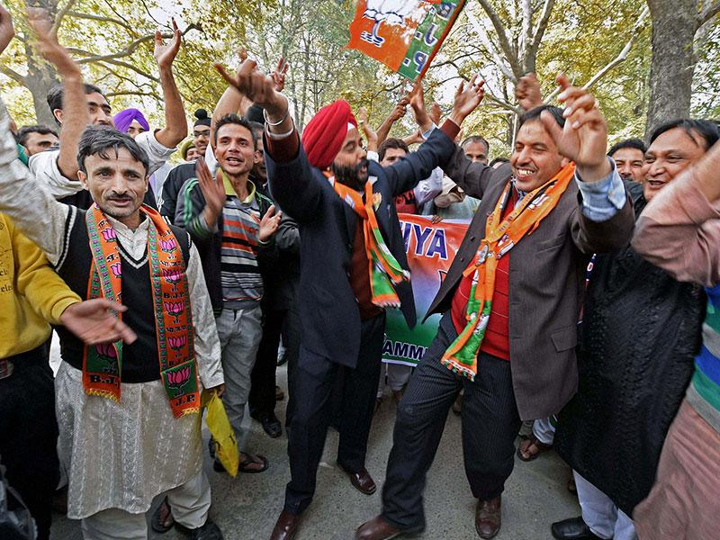 Bharatiya Janata Party (BJP) leaders and workers shout pro-Modi slogans during a welcome rally ahead of Prime Minister Narendra Modi's arrival in Srinagar to celebrate Diwali with the flood victims on Thursday. (PTI photo)