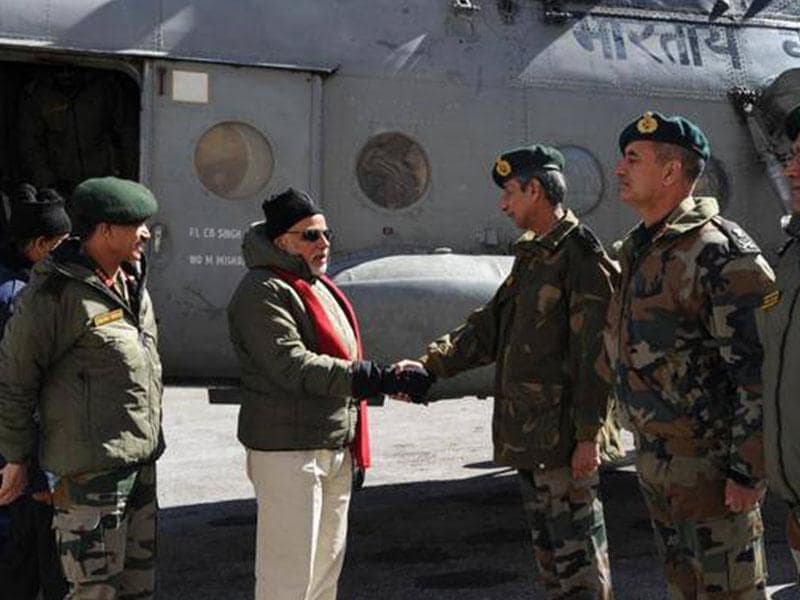 Prime Minister Narendra Modi is received on his arrival at Siachen Base Camp. Army chief Gen Dalbir Singh is also seen. (PTI photo)