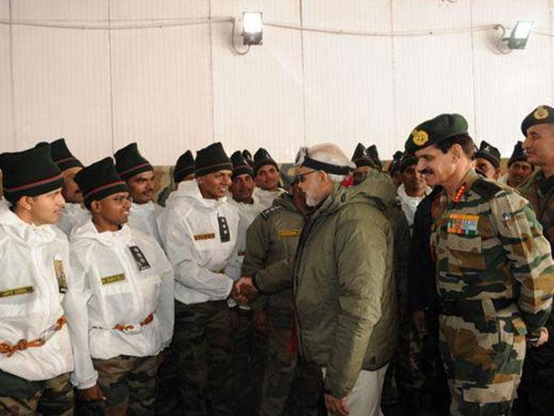 Prime minister Narendra Modi interacts with the Army officers and soldiers at a base camp during his visit to Siachen. (PTI photo)
