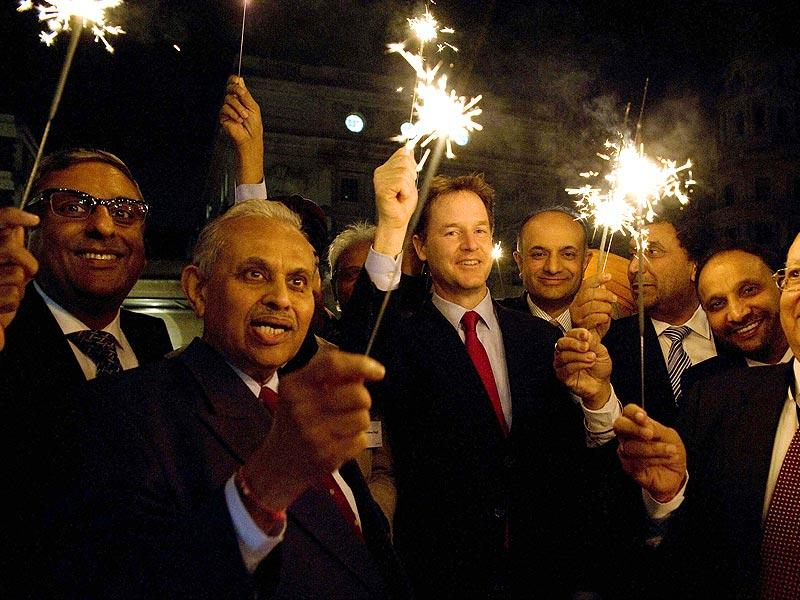 UK's deputy prime minister Nick Clegg celebrate Diwali with Indian-origin parliamentarians and businessman in London on Wednesday. (PTI Photo)