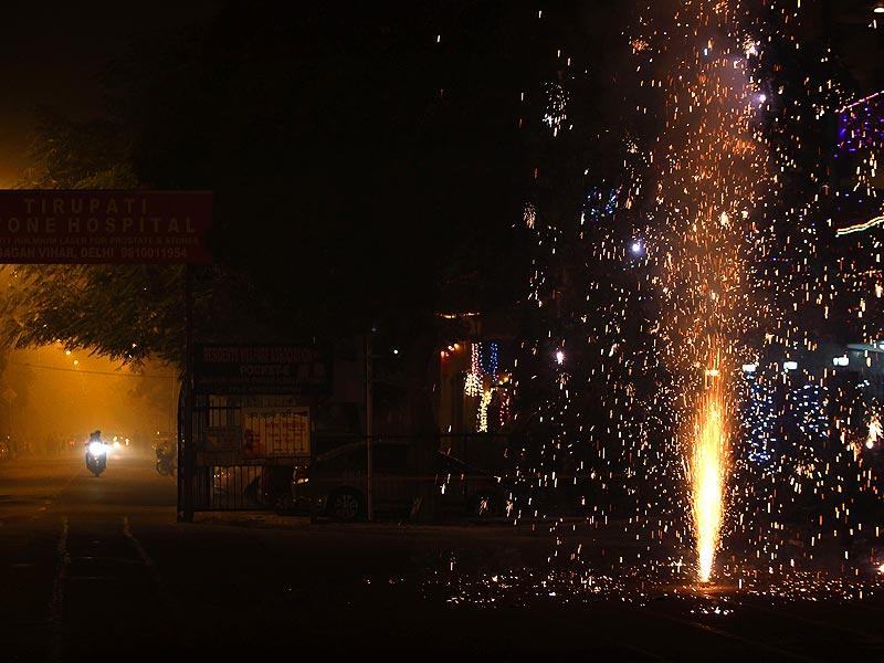 People celebrate Diwali in New Delhi on Thursday. (Ajay Aggarwal/HT Photo)