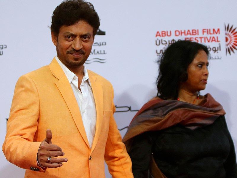 Actor Irfan Khan poses for a picture as he arrives for the opening of 8th edition of the Abu Dhabi Film Festival (ADFF), in Abu Dhabi on October 23, 2014.    (AFP)