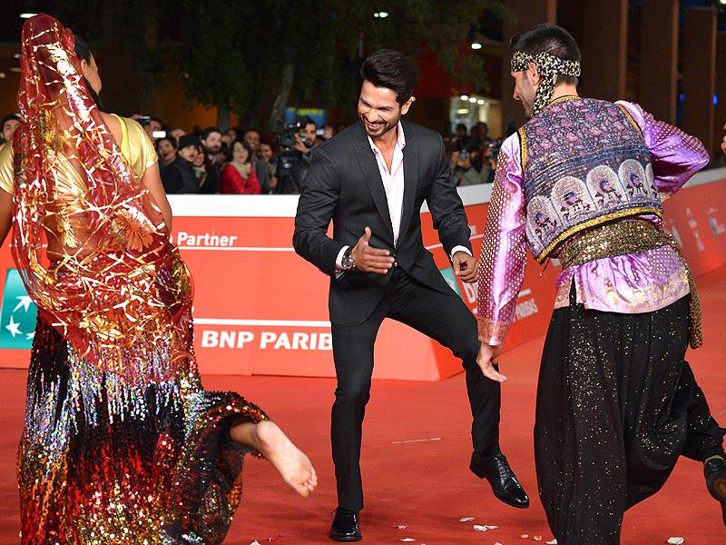 Shahid Kapoor dances with performers on the red carpet as he arrives for the screening of the movie Haider, in which he stars, during the Rome Film Festival in Rome on October 24. (All pictures: AFP)