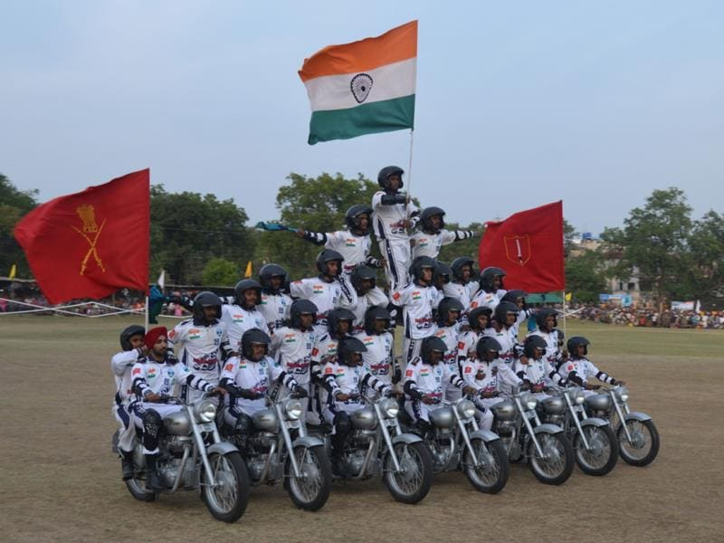 Army personnel display motorcycle stunts to commemorate landing of the first infantry elements of the Indian Army at Srinagar Airfield in 1947, at Infantry School, Mhow. (HT photo)