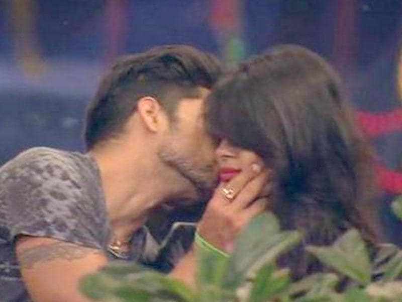 Gautam gives a peek on the cheek to Sonali.