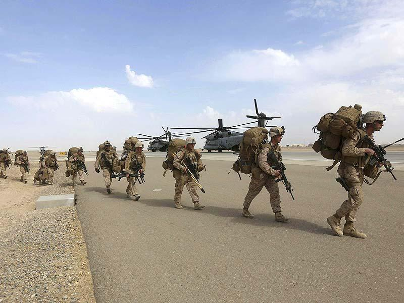 US Marines prepare to depart upon the end of operations for Marines and British combat troops in Helmand. (Reuters Photo)