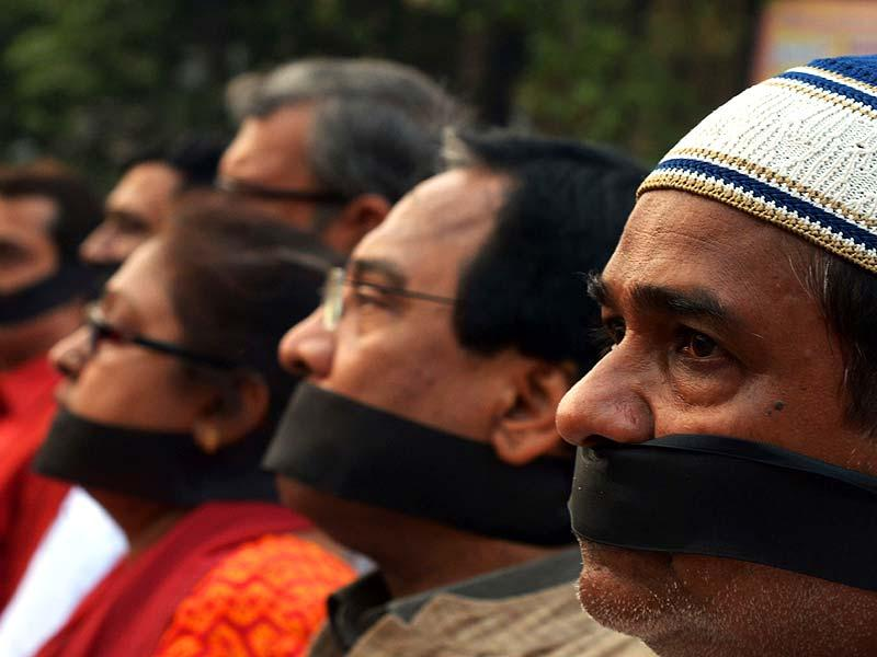 BJP activists wearing black cloth tied around their mounths take part in a protest in Kolkata. (AFP Photo)