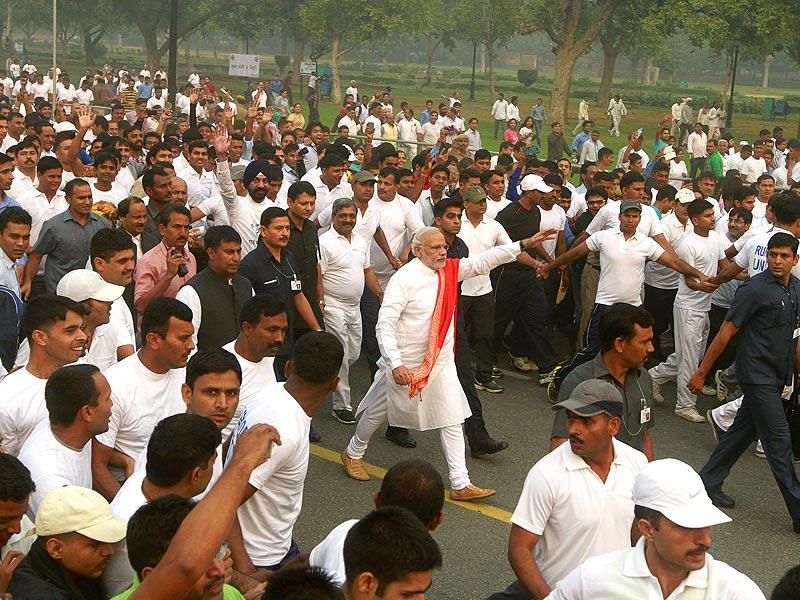 PM Modi takes part in the 'Run for Unity' at Rajpath in New Delhi on Friday. (Sanjeev Verma/HT Photo)