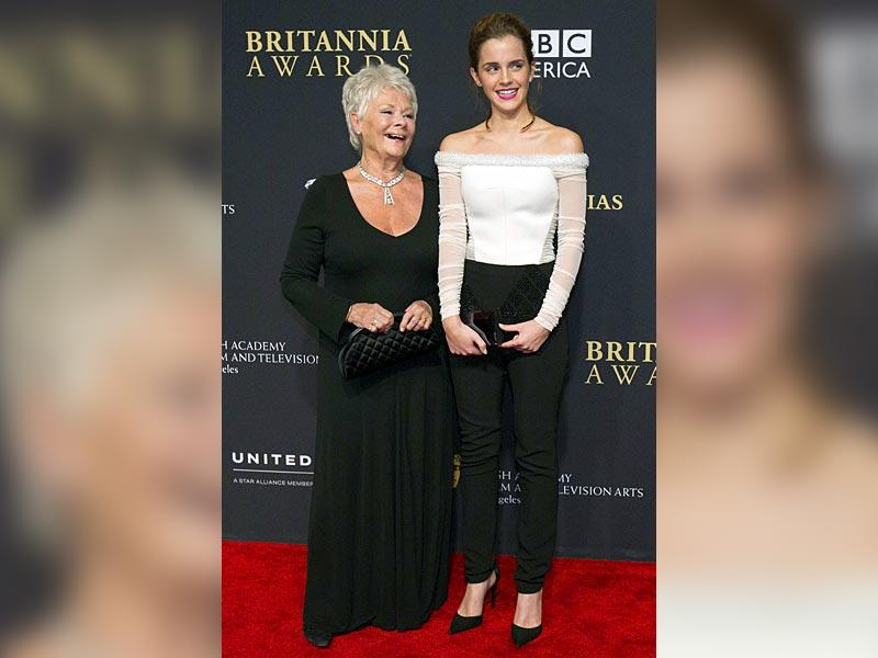 Actors Judi Dench (L) and Emma Watson pose at the BAFTA Los Angeles Britannia Awards at the Beverly Hilton hotel in Beverly Hills, California October 30, 2014. (Reuters)
