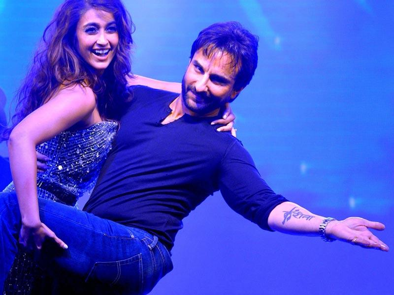 Saif Ali Khan and Ileana D'Cruz perform during the music launch of Happy Ending. (AFP Photo)