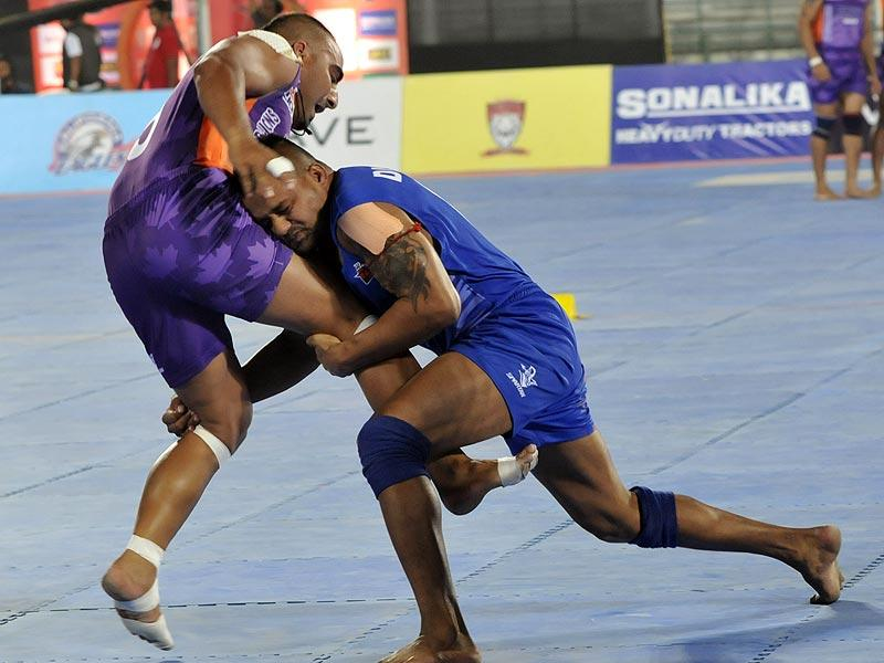 Players in action during WAVE World Kabaddi League match between United Singhs and Vencoover Lions in Bhopal on Friday. (Mujeeb Faruqui/HT photo)