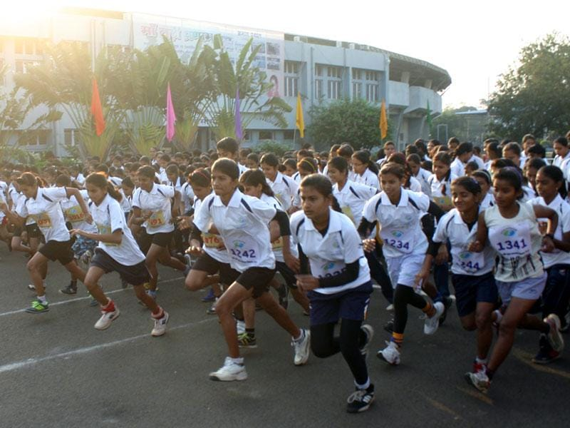 Girls take part in a mini marathon during Madhya Pradesh Foundation Day celebrations in Bhopal on Saturday. (HT photo)