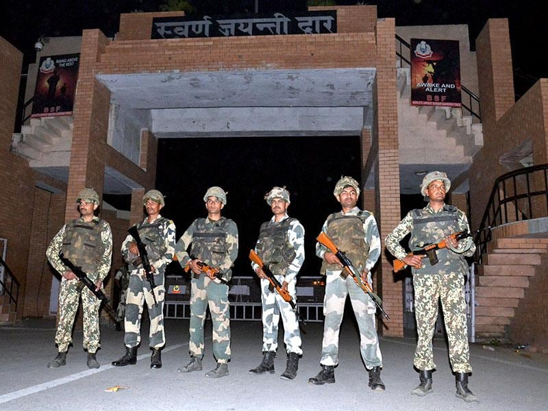 BSF jawans take positions at Swarn Jayanti Dwar at Attari international border after Sunday's bomb blast at Wagah checkpoint. (PTI Photo)