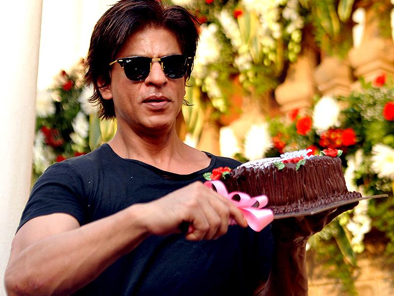 Bollywood actor Shah Rukh Khan poses for a photograph during a photocall for his 49th birthday celebrations at his home in Mumbai on November 2, 2014. (AFP)