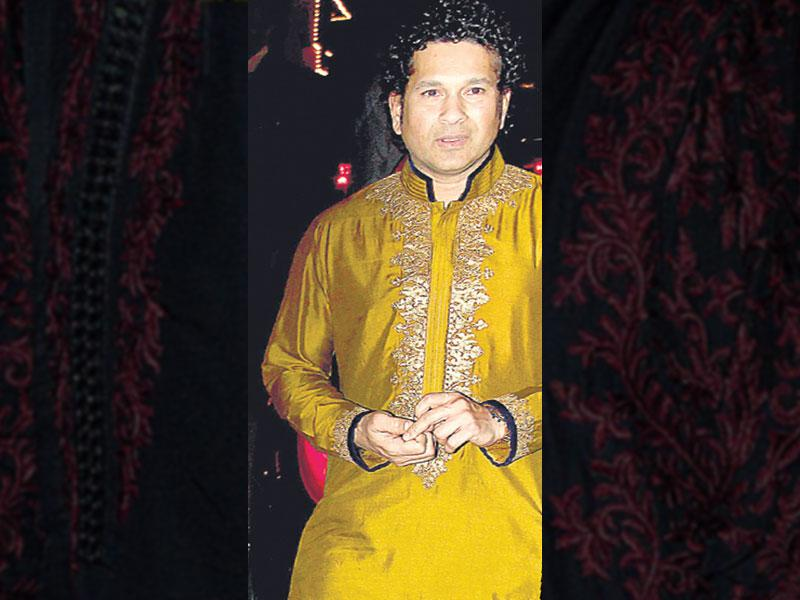 Sachin Tendulkar: Cricketer Sachin Tendulkar definitely bowled many over with his traditional look at a do. Experimenting with colours, he wore a mustard coloured kurta with golden embroidery that was paired with a navy blue churidaar.
