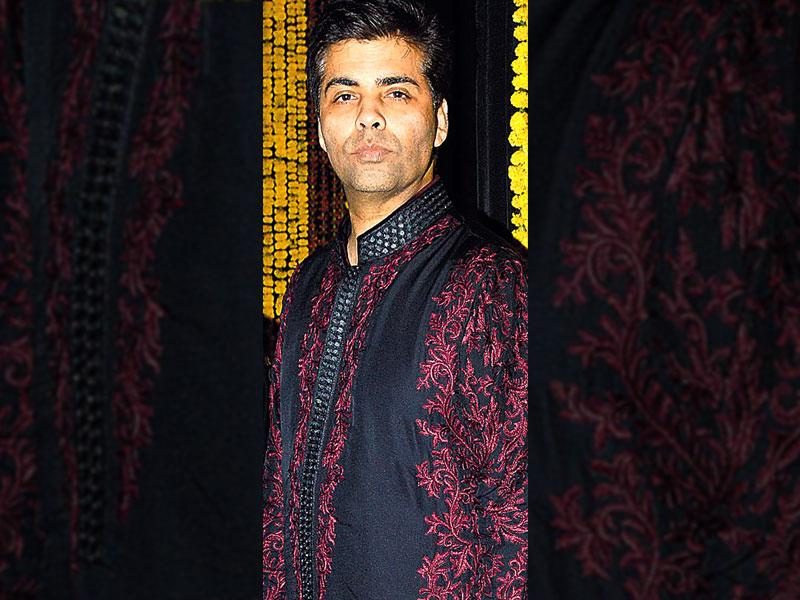 Rarely, do men make an effort to dress-up in traditional attires. Given the fact that last month was full of festivities, there were many Mumbai celebs, who were spotted in kurta pajamas and looked dashing. While some accessorised it with stoles and jackets, others decided to stick to the simple yet stylish look. Here are some style cues that men can take from these celebs, given that the wedding season is about to start soon. (Text by: Kanika Sharma/ kanika.sharma@hindustantimes.com) Karan Johar: Director Karan Johar known for his 'suit' look, decided to stick to the desi theme this time, as he wore a black kurta with wine coloured embroidery that was paired with a white churidaar with black loafers.