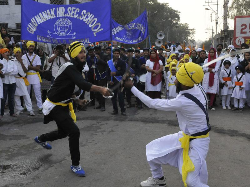 Young Sikhs perform martial arts on the occasion of Guru Nanak's Prakash Parv, in Bhopal on Monday. (Mujeeb Faruqui/HT photo)