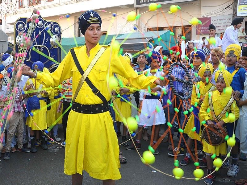 Young Sikhs demonstrate their Gatka martial art skills.