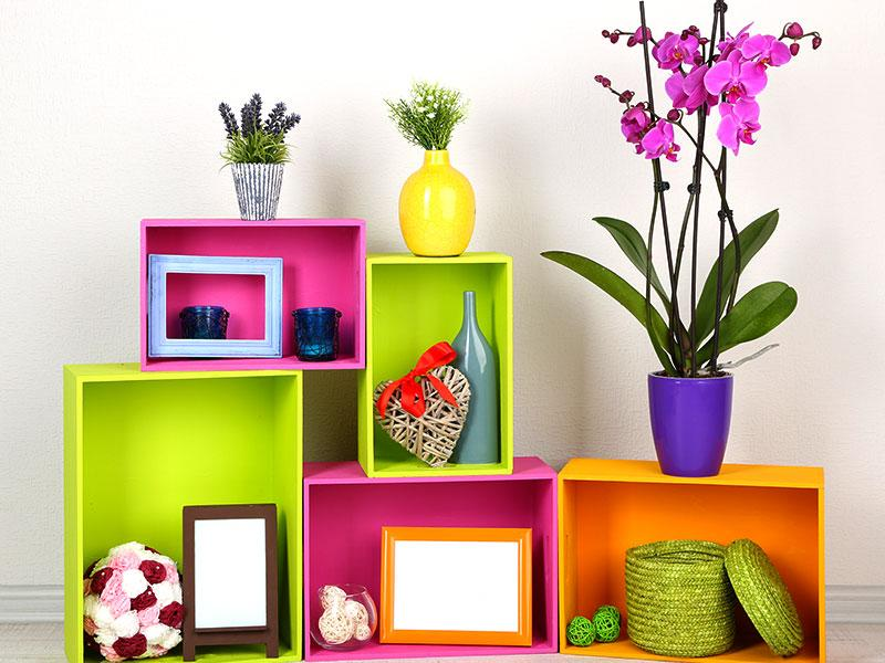 Have an empty shelf and looking for ideas to use the space? Get out those old cardboard boxes and colour them bright. Adore them with knick-knacks and you are good to go!