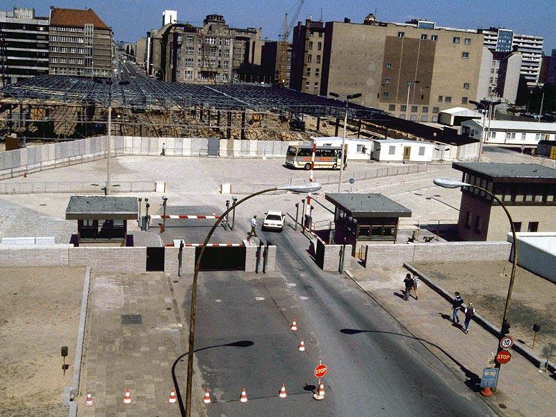 The Aug. 13, 1985 file photo shows a view into East Berlin from West Berlin at Checkpoint Charlie. The construction works on East Berlin side of checkpoint were new control barracks. (AP Photo)