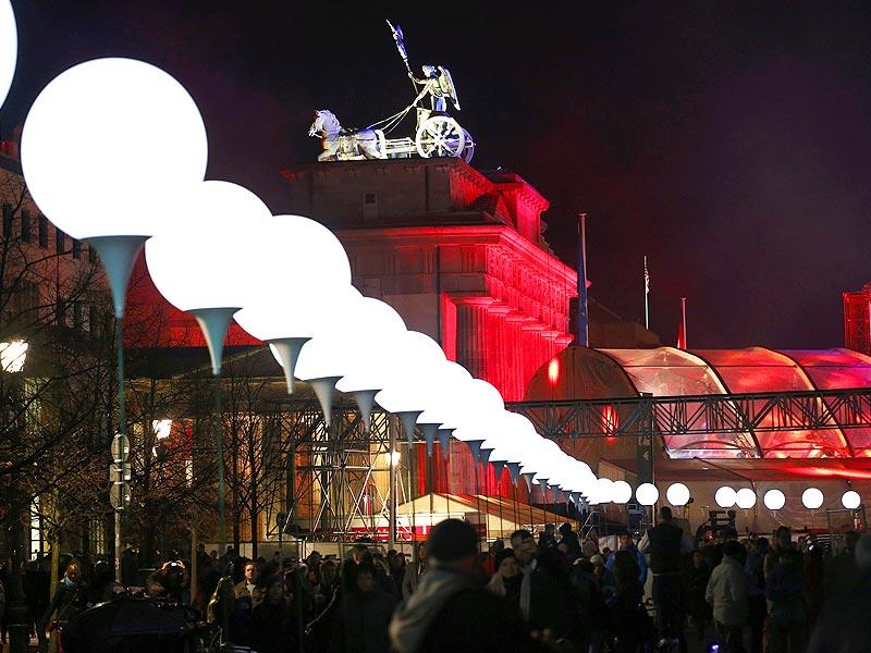 Lit balloons are placed along the former Berlin Wall location near the Brandenburg Gate in Berlin. (Reuters Photo)