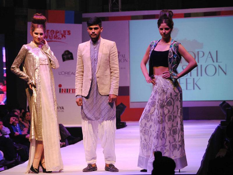 Models walk the ramp on the first day of Bhopal Fashion Week. The two-day event will showcase the work of designers from all over India. (HT photo)