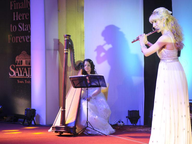 Women from Belgium play harp and flute during the inaugural celebration of Sayaji Hotel in Bhopal. (Mujeeb Faruqui/HT photo)