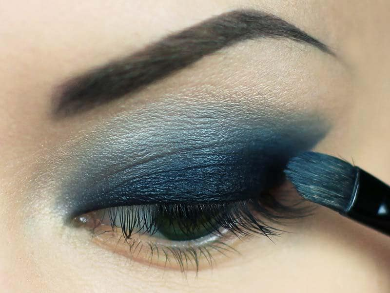 Scribble on your crease: Apply the liner just halfway along the crease of your eye and smudge as you go. Smudging is key here, as your goal is to leave no trace of any harsh lines.