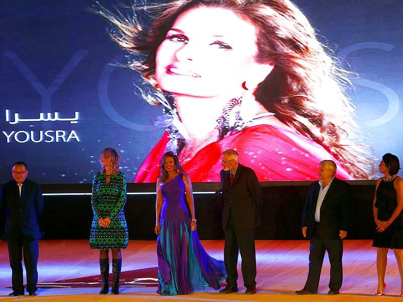 Egyptian actor Yousra (3rd L), the chairperson of the jury of the International Competition, attends with other members of the jury during the opening ceremony of the 36th Cairo International Film Festival (CIFF) at the Citadel of Salah El Din in Cairo November 9, 2014. The festival will end on November 18. (Reuters)