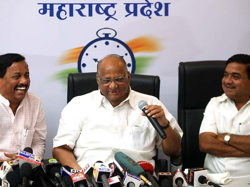 NCP chief Sharad Pawar with party leaders Sunil Tatkare and RR Patil interacts with media in Mumbai. (Kunal Patil/HT photo)