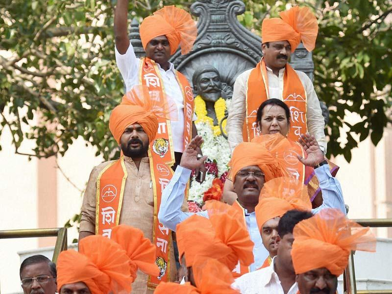 Shiv Sena MLAs arrive at Vidhan Bhavan for the 3-day special session of Maharashtra assembly. (PTI photo)