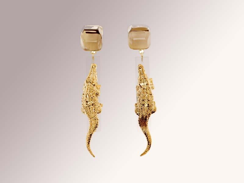 Bimba Y Lola earrings: Ditto for these crocodile earrings from Spanish brand Bimba Y Lola. Made from translucent resin and gold colored brass, they're a fun and affordable way to add a little extra bite to your eveningwear. €65 (Almost Rs 6,400)