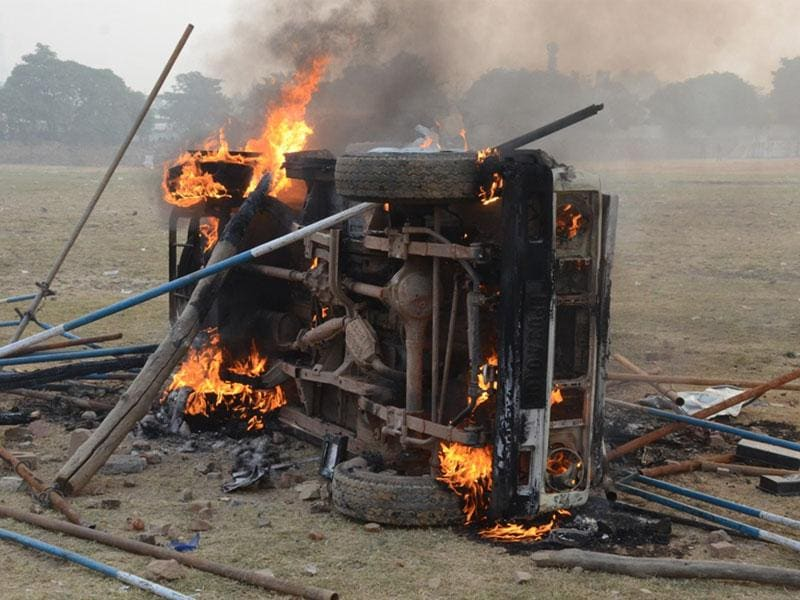 A vehicle set on fire by some candidates of Army recruitment test in Gwalior on Wednesday. (HT photo)