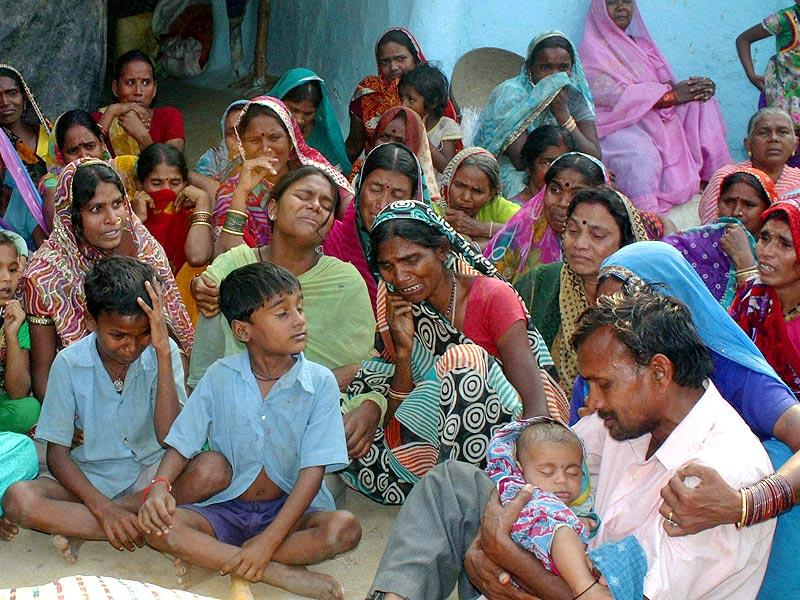 Relatives mourn death of women who died after she underwent sterilization surgeries, at Dhruv Ameri village in Bilaspur. (PTI Photo)