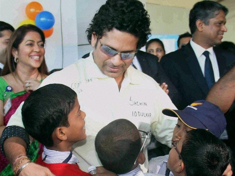 Sachin Tendulkar meets under-privileged and special kids during a event on the eve of Children's day at Santacruz domestic airport in Mumbai. (PTI photo)