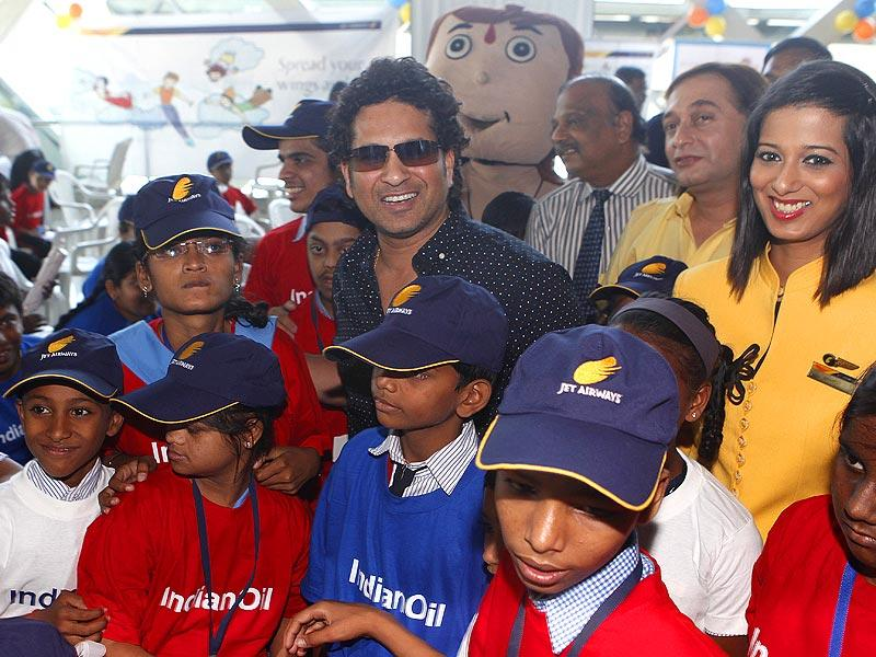 Sachin Tendulkar meets under-privileged and special kids during a event on the eve of Children's day at Santacruz domestic airport in Mumbai. After this, the kids where taken on an airplane ride. (Vidya Subramanian/HT photo)