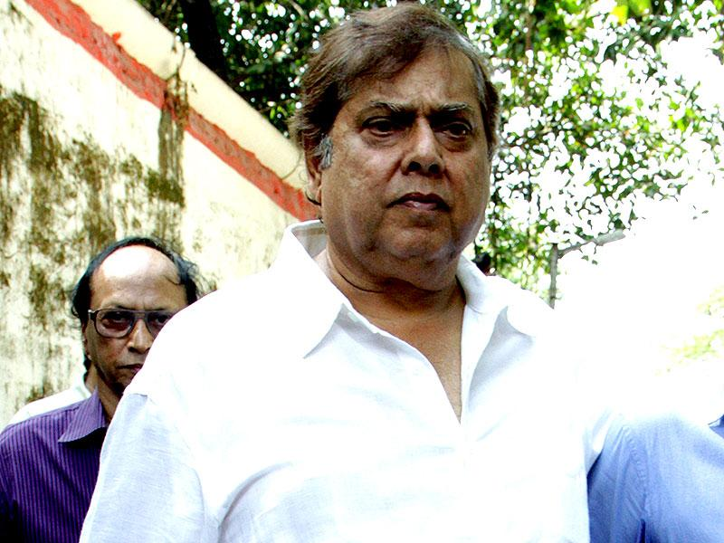 David Dhawan at the funeral of Bollywood film producer and director Ravi Chopra in Mumbai on November 13, 2014. (AFP Photo)