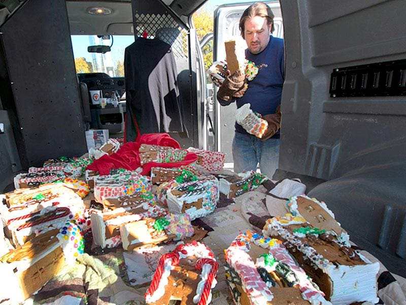 Chef Jon Lovitch collects some of his gingerbread house creations from his van to add to his GingerBread Lane display, at the New York Hall of Science, in the Queens borough of New York. (AP photo)